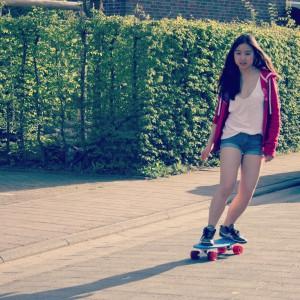 Sophie skating on her cruiser